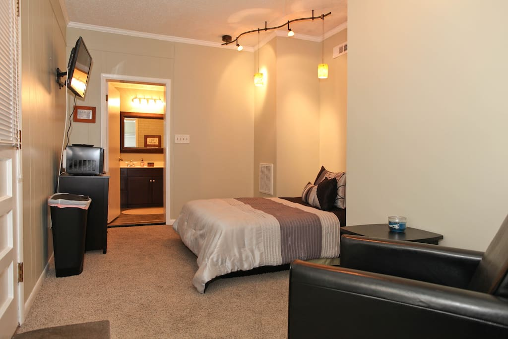 Entry is on the immediate near left.  Cozy sleeping alcove with storage drawers in the cabinet across from the foot of the bed.
