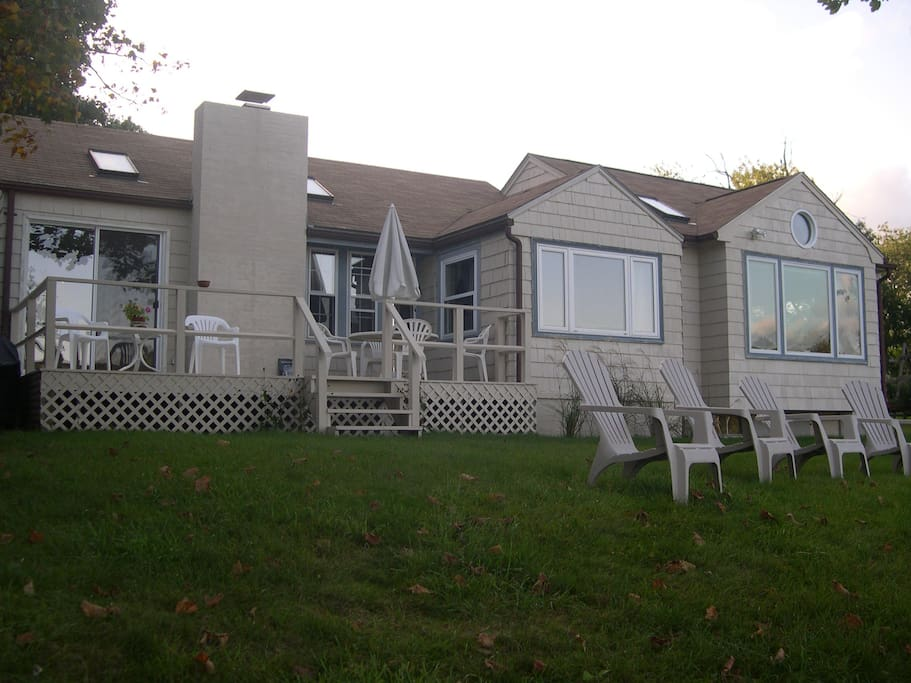 Front view of house facing river. Shows dinning/living room, 1 bedroom and family room with great river views!