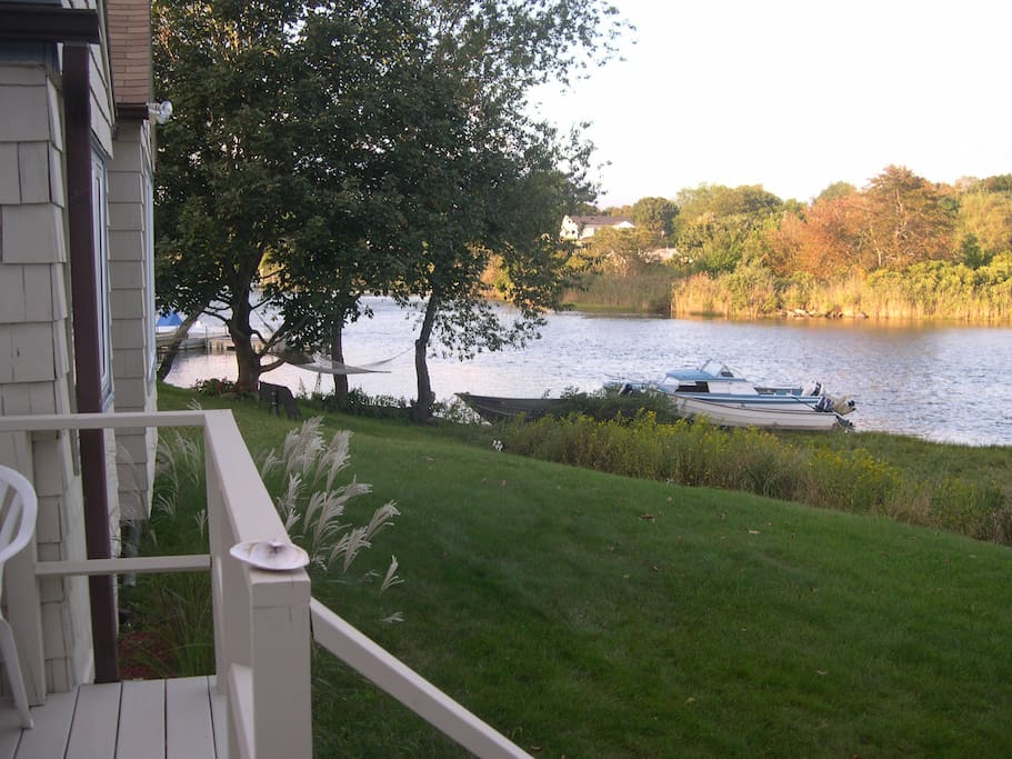 From deck view north down river, which leads to two fresh water lakes. Great water skiing, tubing etc.!