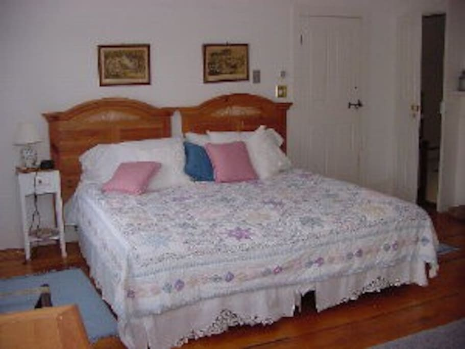 The large King Size Bed in the spacious Captain's Quarters.