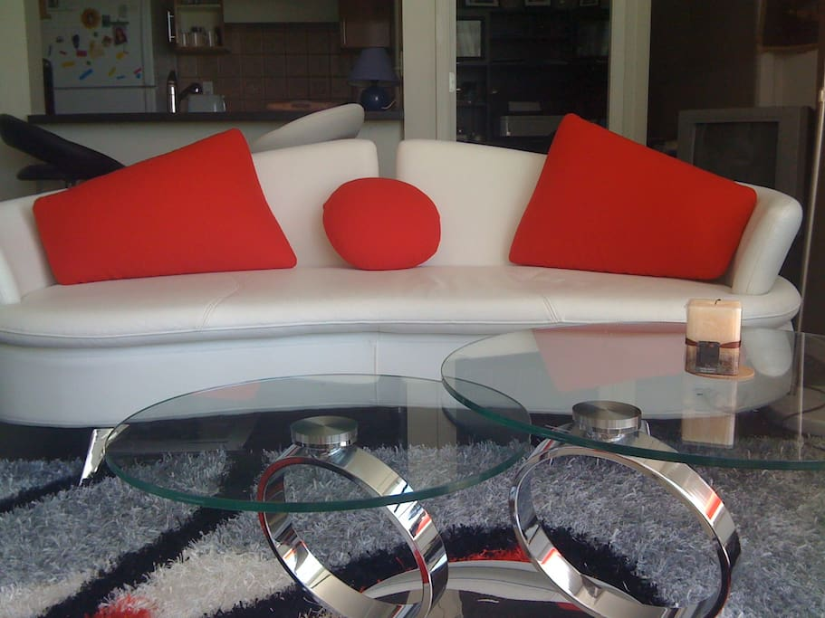 Modern chic: Contemporary high end white leather furniture with red accents
