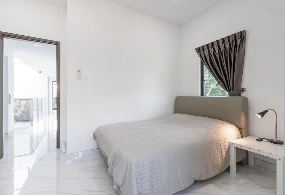 spacious master bedroom with queen bed, side table + LED table lamp