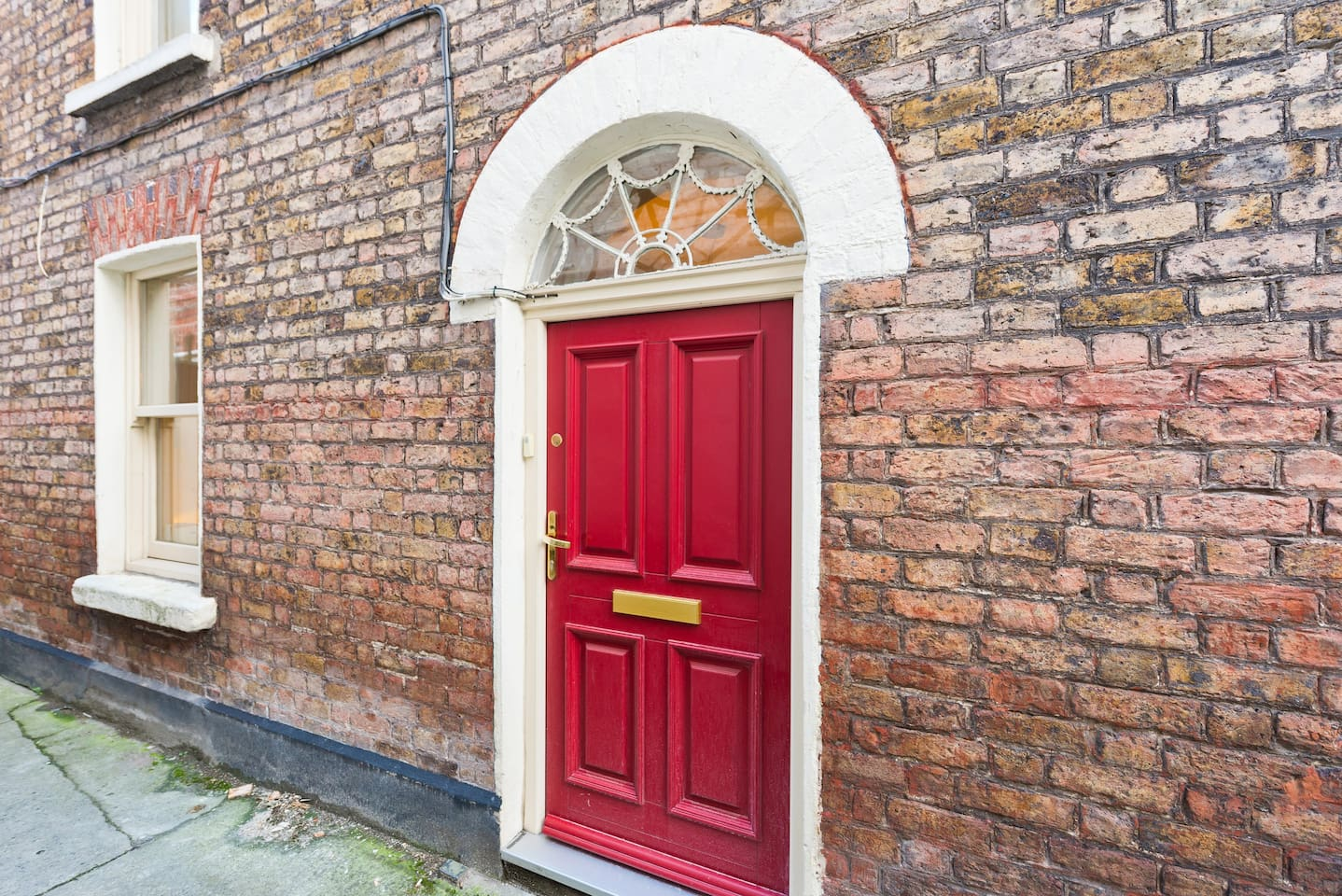 Our little period house with distinctive red doors sits hidden away on a Camden Street alleyway