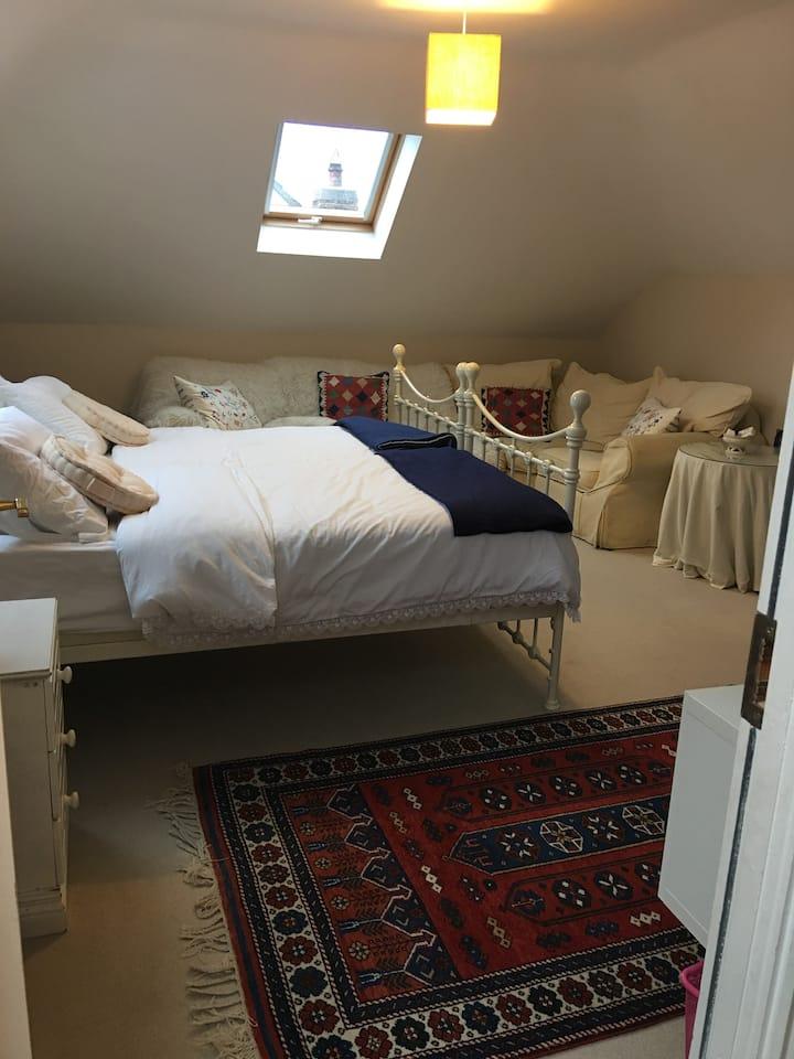 Top Floor with Private Bathroom sofa + mini fridge