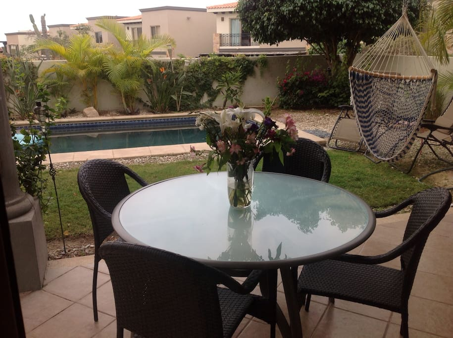 You can enjoy breakfast, your BBQ or a favorite beverage on the back patio table.  The chairs are comfortable too.