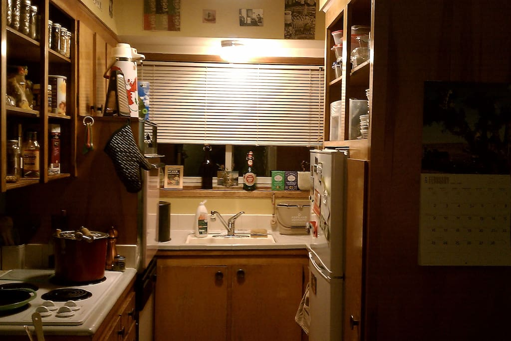The kitchen at night -- pink stove and all