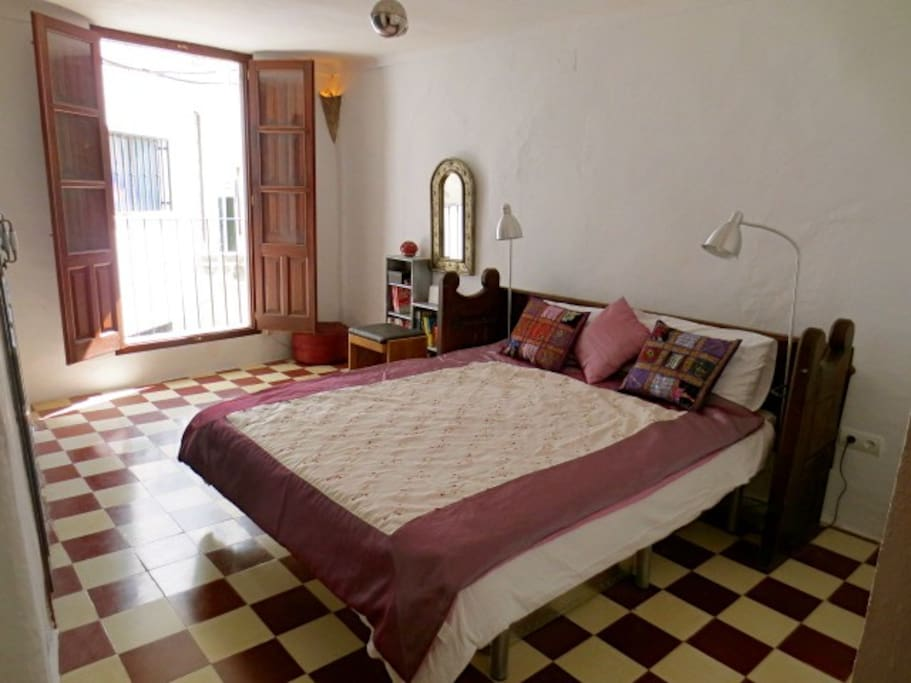 Bedroom 2 has a small balcony and views of the church square