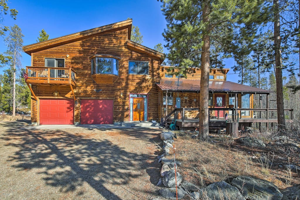 Situated on a 1-acre lot surrounded by pine and aspen trees, this home offers serene wooded views