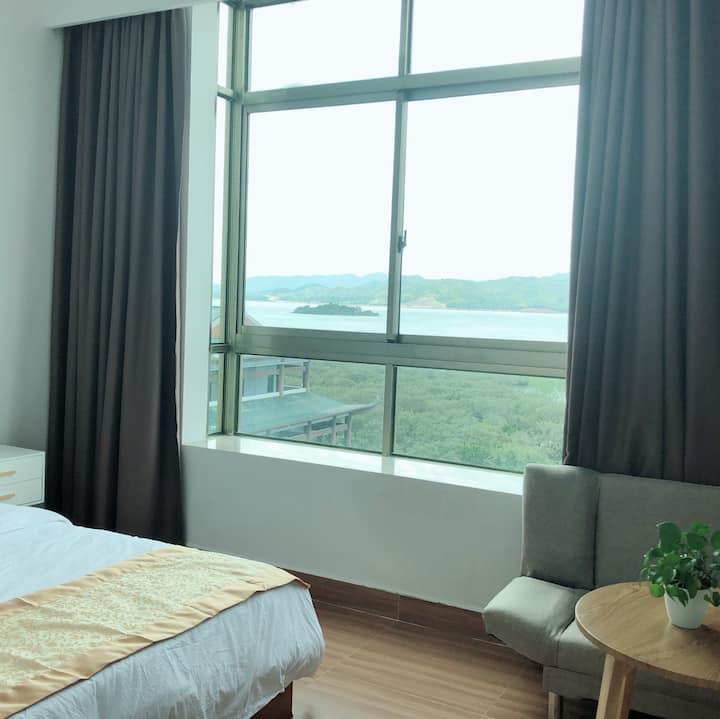 04海景1.8大床房,推窗观白鹭