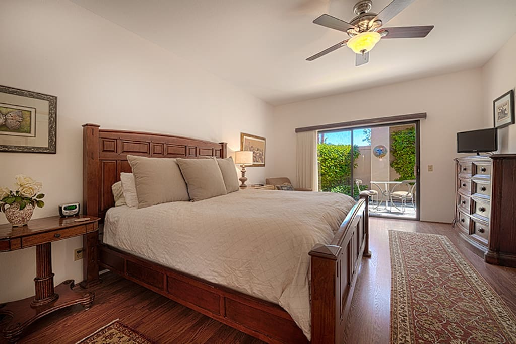 Beautiful master bedroom with HDTV and private patio