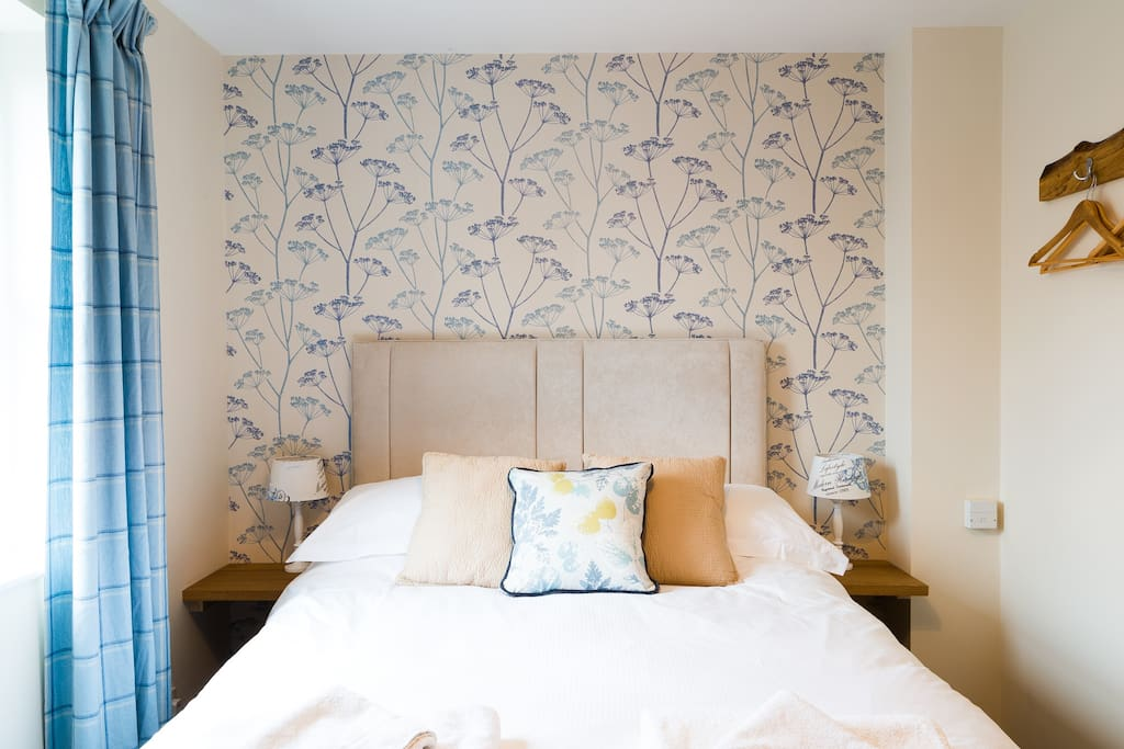 Lovely  fresh,crisp bedding and towels are provided for guests. Oak hand made hanging clothes hooks.