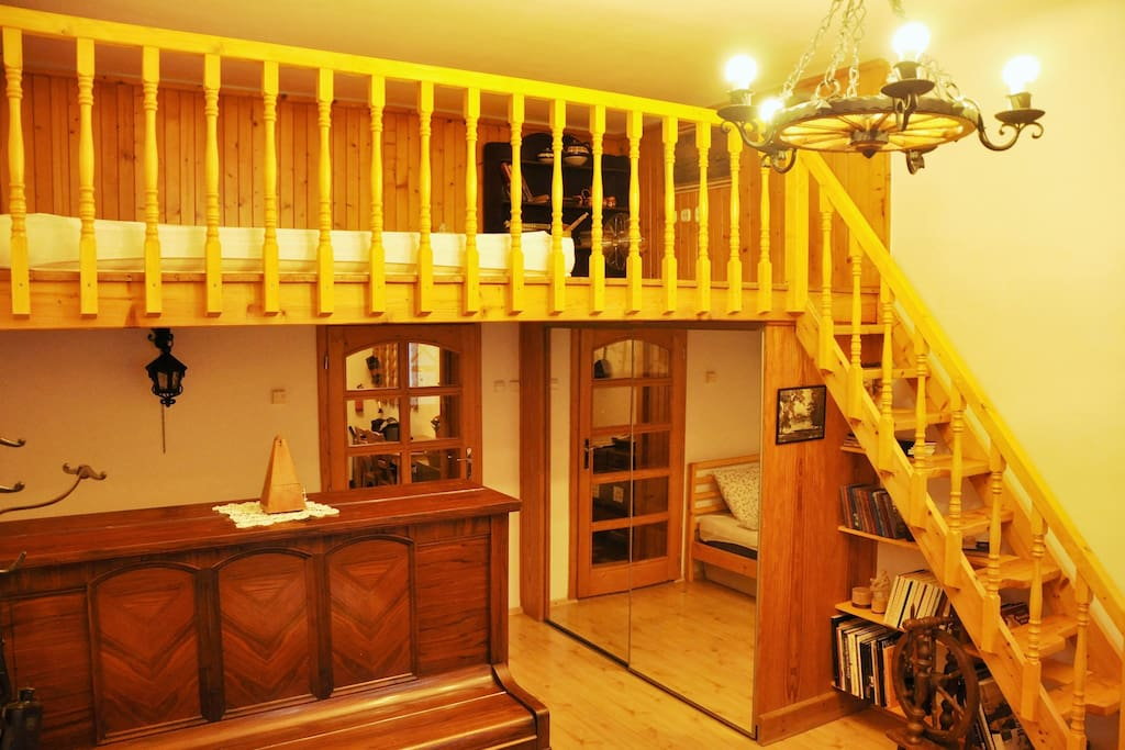 Wooden stairs and loft is adding warm feeling