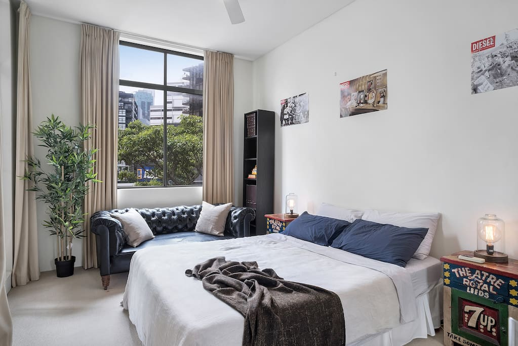 Spacious and private main bedroom is set on the right side of the apartment with a door and blackout curtains. Lights by the bed for a cosy mood lighting at night.