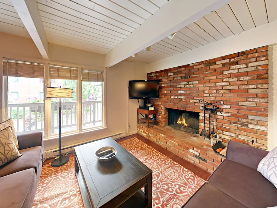 Curl up on 2 plush sofas around the wood-burning fireplace in the living room.