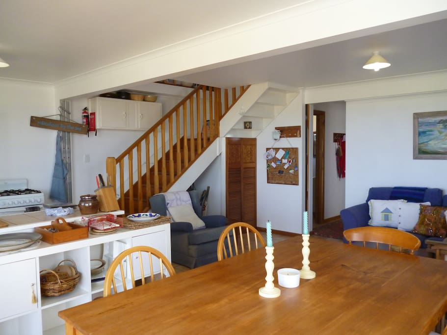 Living kitchen area opens onto a large deck.