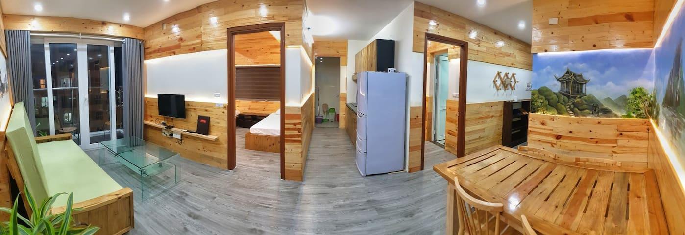 Arrangement of 2 bed rooms and the kitchen in between.
