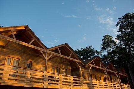 Habitacione por grupo de 4 cabañas frente al mar