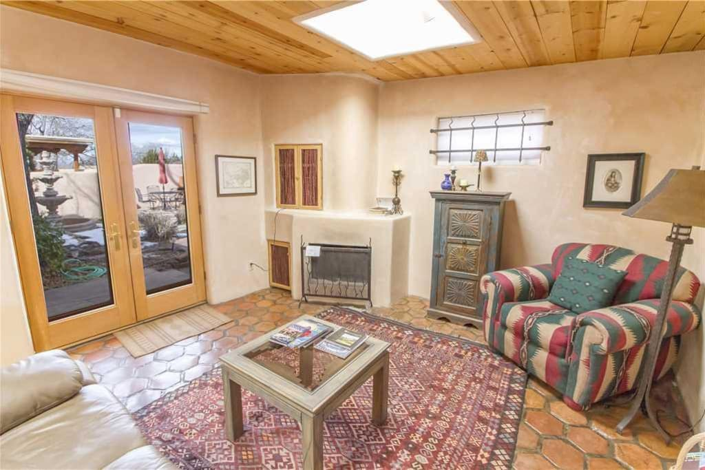 Grab a book or magazine and enjoy the warmth of the living room fireplace.