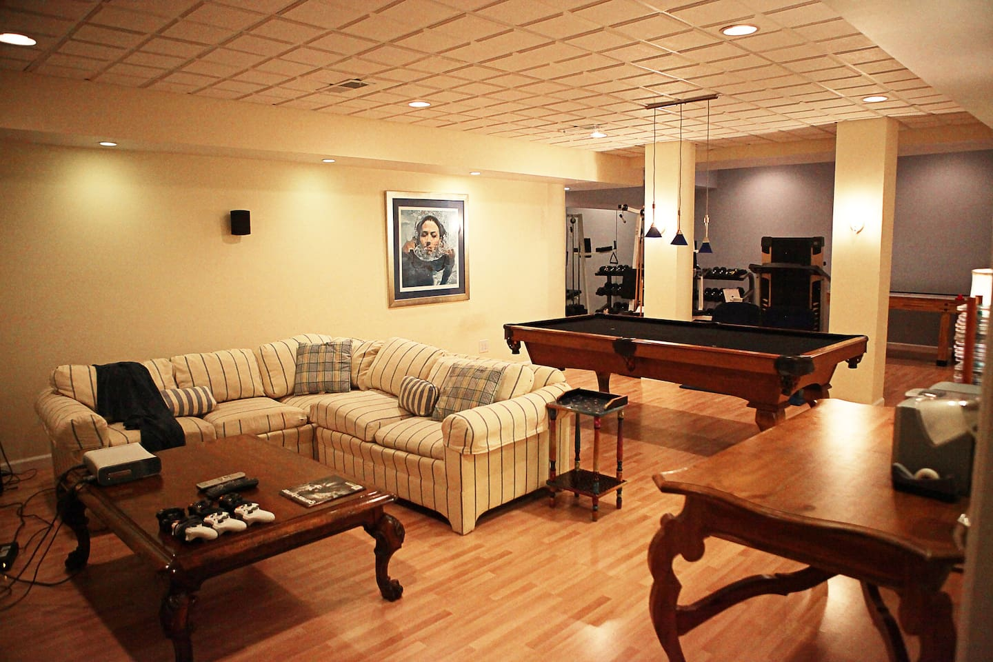 Stay in comfort and relax by watching television, playing pool, or working out