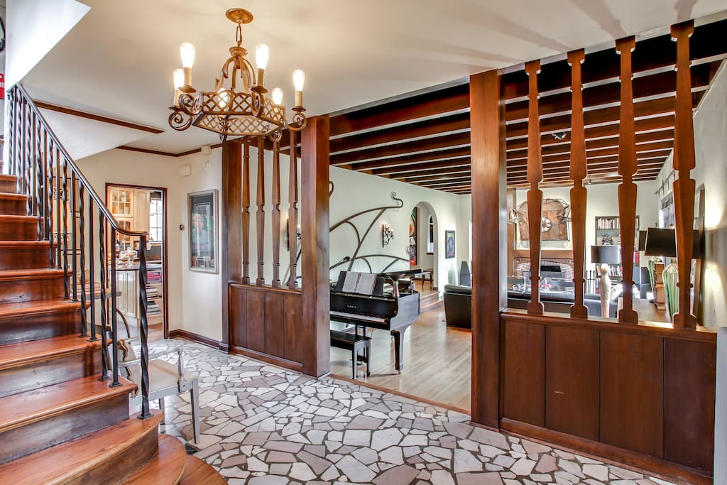 Walk into history, the entry's original 1928 walnut woodwork, marble mosaic floor and wrought iron railings.