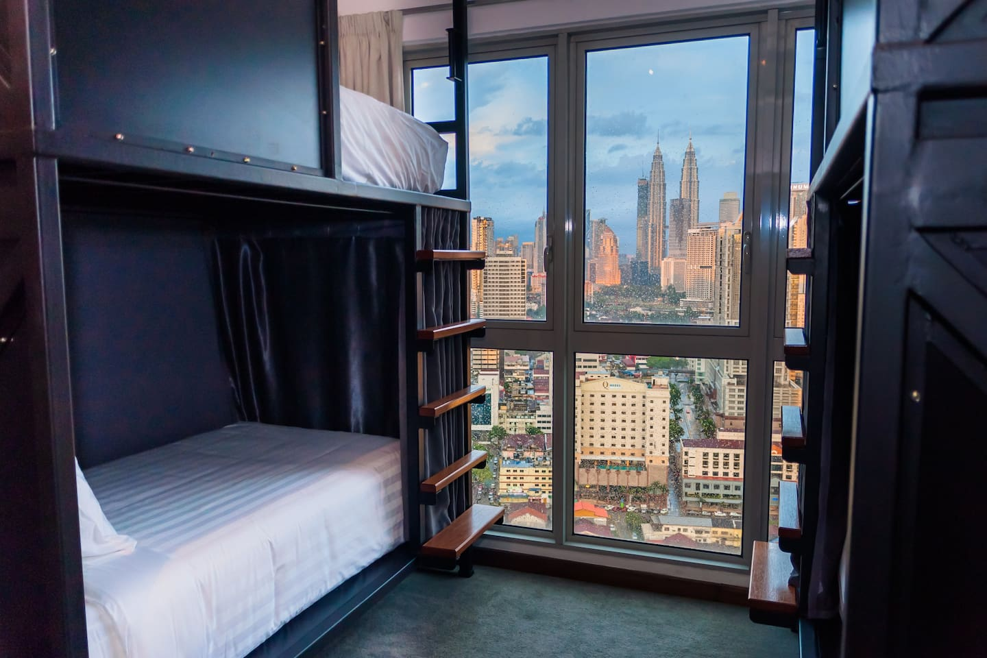 FACING PETRONAS TWIN TOWER VIEW! Super Thick Soft Heavenly Luxury Bed , Fully Carpeted + Sound Proofed, Privacy Curtains around bed, 24 hour a/c, Huge Solid Locker 80Litre- locks provided and high security- all guests must be registered at reception