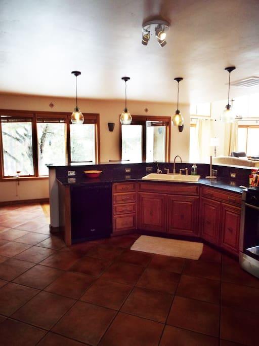 Kitchen and Bar facing west patios, main floor