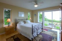Master Bedroom with queen bed, dresser and television with DVD player