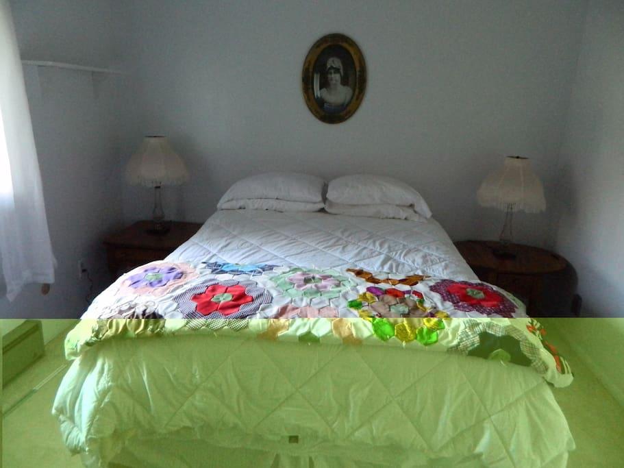 Queen bed.  New posturpedic mattress.