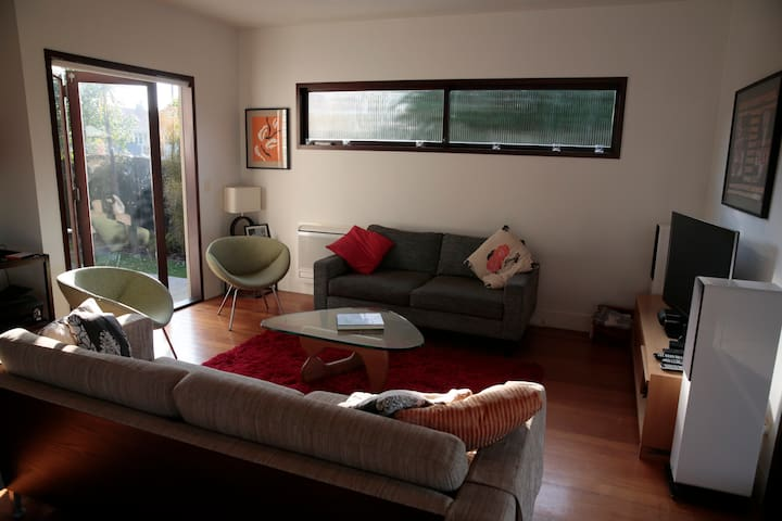 Light and airy with access to side patio and to covered deck