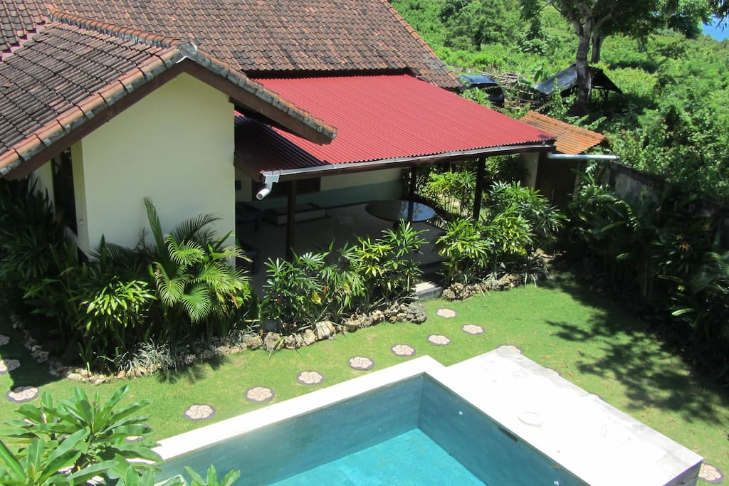 This is the main house with the pool in between the 2 houses .