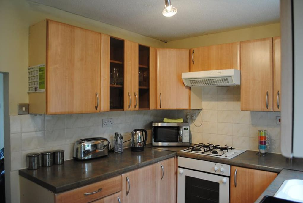 Equipped kitchen with fridge freezer & ample cupboard space.
