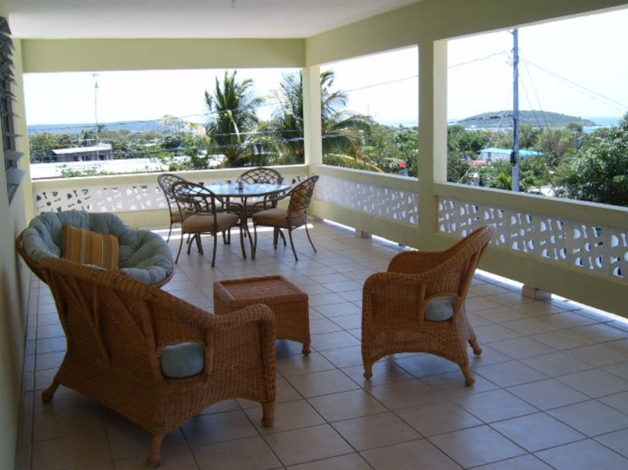 Your private terrace overlooking the Esperanza shoreline has lots of space for lounging and dining.