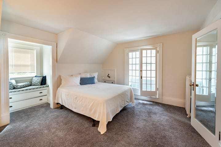 Large bedroom with lots of storage and a small alcove for relaxing or reading.