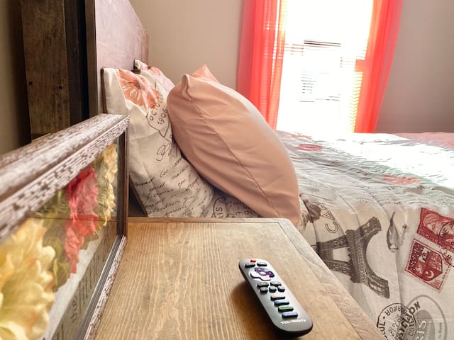 Full/queen bed with Roku tv and storage closet