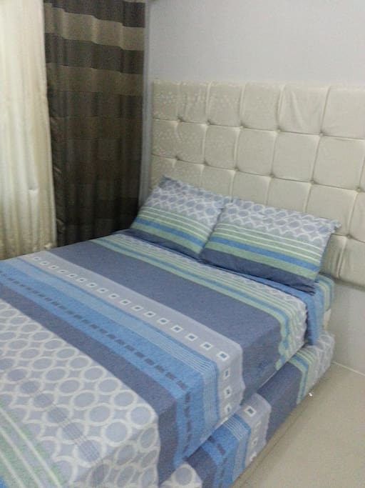 Double bed with a pull-out mattress