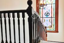 Featuring large stain glass windows - just pull the chord for the lights. This staircase is between 2 bedrooms and bathroom and toilet on the top floor and the downstairs living areas.