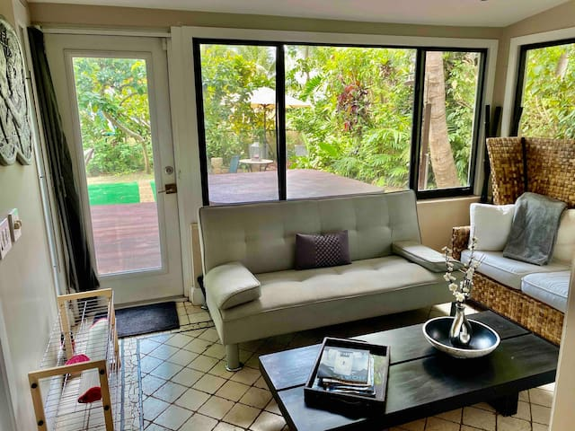 Additional sunroom that could become a third bedroom, sofa opens to an additional bed.