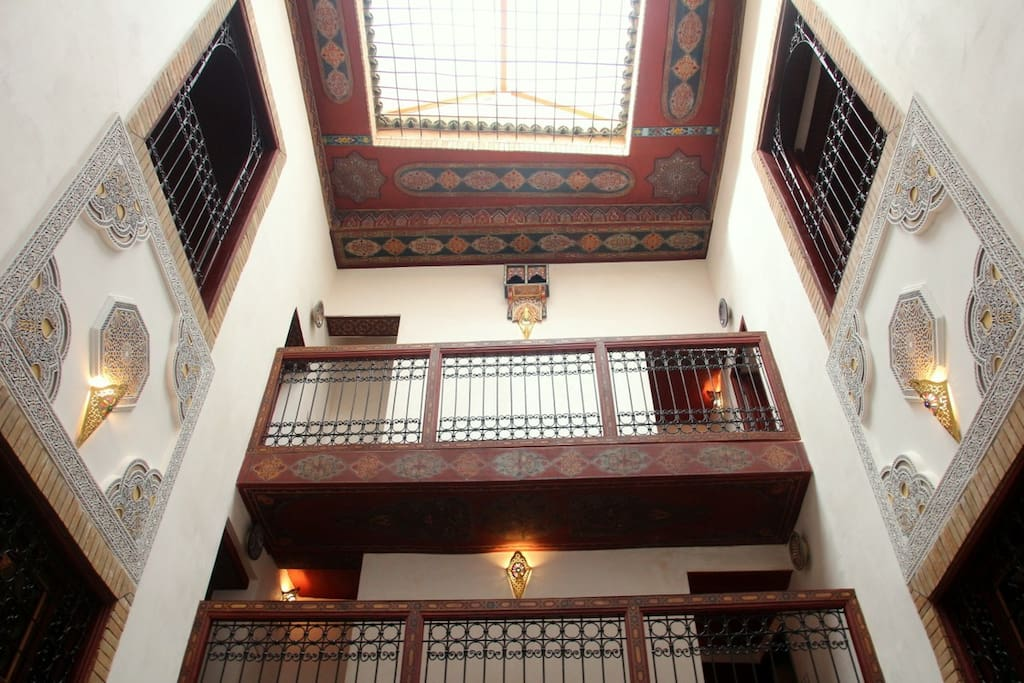 the soaring ceiling of 300 year old Dar Sondos has traditional details