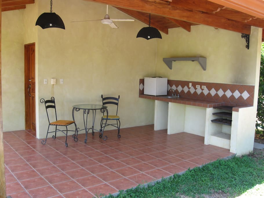 Outdoor kitchen with grill and mini fridge