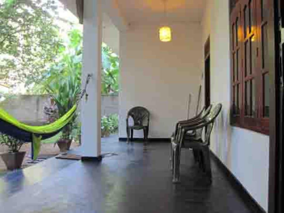 Outdoor ground floor seating and hammock