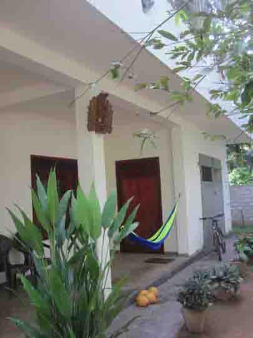 Open ground floor veranda and garage entrance