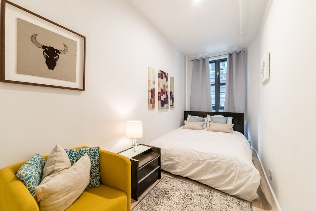 The spacious 2nd Master Bedroom features a large Queen size Bed. Brand new mattress & bedding & its own seating area. Great design & new accents. This room has its own closet space.