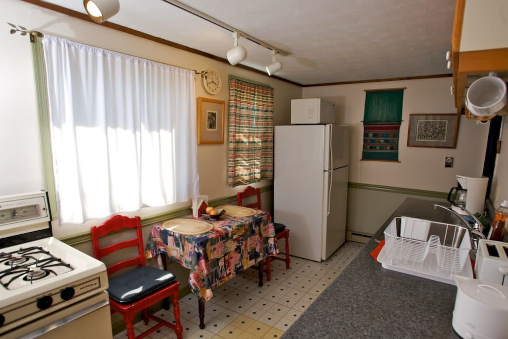 Cheerful, south-facing kitchen with full fridge microwave and stove
