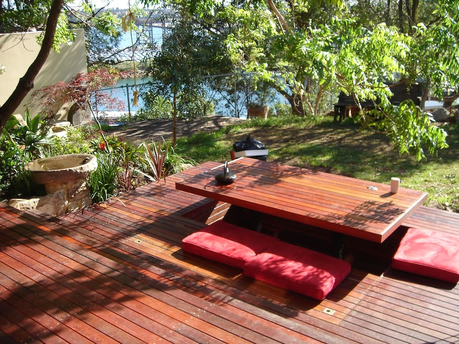 Outdoor entertaining area with park access and harbour views
