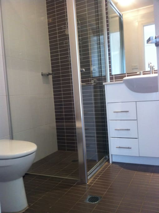 Private bathroom next to bedroom.