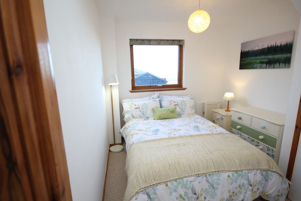 Double Bedroom in a day light. Window with Kessock Bridge view