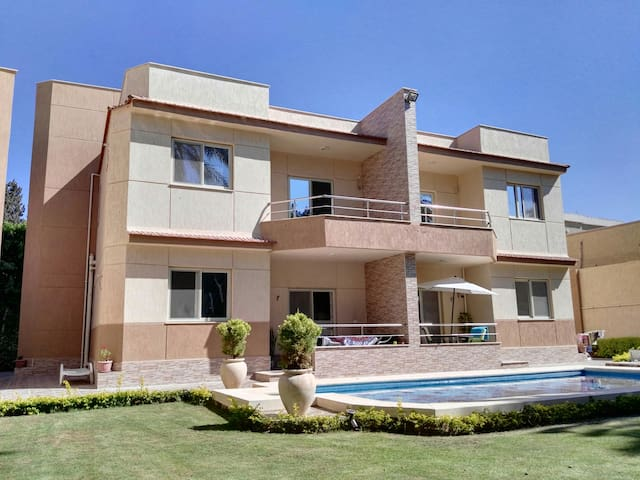 New guest house with pool & garden near Airport