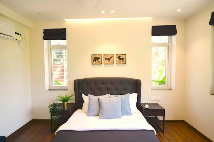 Modern King-Size Bed | Wingback Tufted Headboard | Bedside Tables | Split Air Conditioning | 2 Bedroom Suite | Swimming Pool | Housekeeping Services