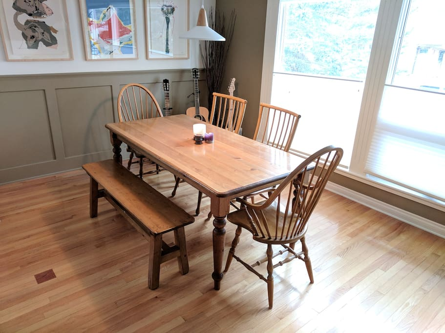 Dining table in the open plan kitchen/dining/living space with stunning views.
