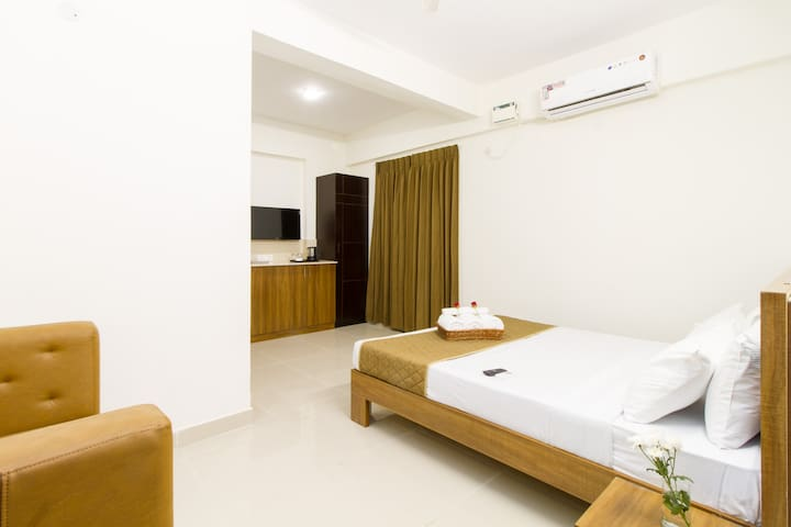 Kitchenette Room with Queen Bed and Sofa